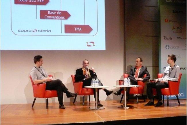 Fabrice Moutte, DSI adjoint de l'IRSTEA, et Philippe Ardouin, DSI de SDE17, (au centre sur le photo) témoignant sur des projets intégrés par Sopra lors de l'Alfresco Day. (crédit : LMI)