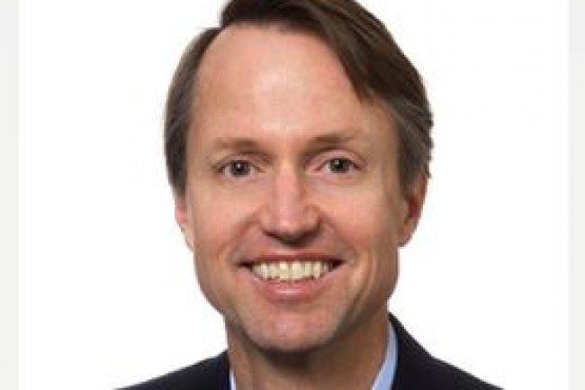 Greg Hughes, CEO de Serena Software rachet� par Micro Focus, pointe la compl�mentarit� de ses offres DevOps avec les solutions de son acqu�reur. (cr�dit : D.R.)