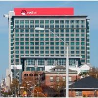 Les bons résultats trimestriels de Red Hat annoncent année meilleure qu'attendue (en illustration le siège de l'éditeur à Raleigh, en Caroline du Nord) Crédit : D.R.
