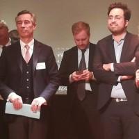 En présence du secrétaire d'Etat chargé du numérique Mounir Mahjoubi (au centre, les bras croisés) et de la députée Agir Laure de La Raudière (à droite), Godefroy de Bentzmann (à gauche) a présenté les voeux de Syntec numérique. (Crédit : Bastien Lion)