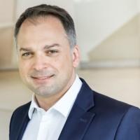 Elie Girard, DG d'Atos depuis le départ de Thierry Breton à la Commission européenne, tente un rapprochement d'envergure avec DXC Technology. (Crédit : Atos)
