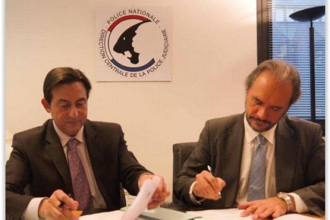 Jean-Marc Souvira commissaire divisionnaire et chef de l'OCRGDF (à gauche) et Joël Courtois, directeur général de l'EPITA (à droite) ont signé un accord pour lutter contre l'escroquerie aux faux virements. (crédit : D.R.)