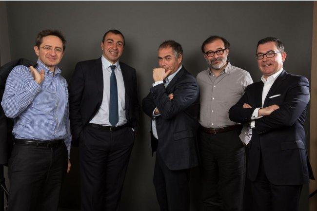 De gauche à droite : Jean-Luc Biache, Mehdi Houas, Eric Benamou, Dominique Masutti et Philippe Cassoulat, dirigeants de Talan.(Cliquez sur l'image pour l'agrandir) Crédit : D.R.
