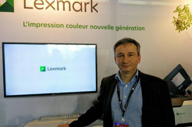 Etienne Maraval, directeur marketing de Lexmark France, sur le salon IT Partners où il présente  Sept nouveaux modèles A4 laser couleur à ses partenaires. (Crédit D.R)