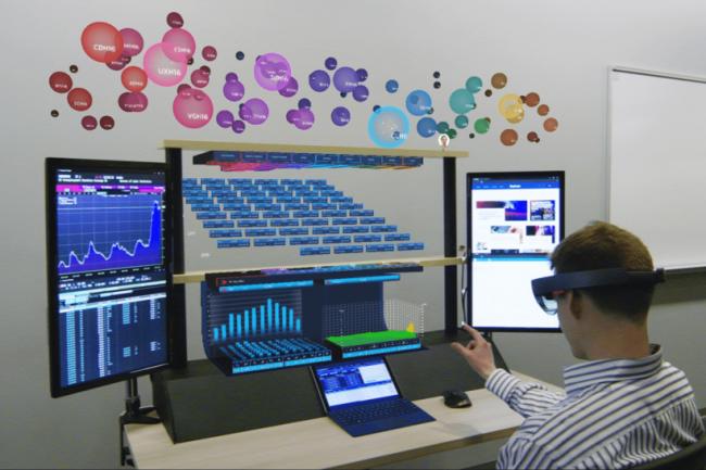Le bureau virtuel de 8Ninths occupe un grand espace devant l'utilisateur pour afficher des images holographiques.