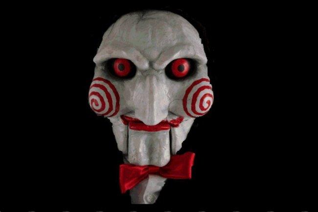 Le ransomware Jigsaw accompagne son message de menace du masque du tueur de la série Saw. (crédit : BleepingComputer.com)