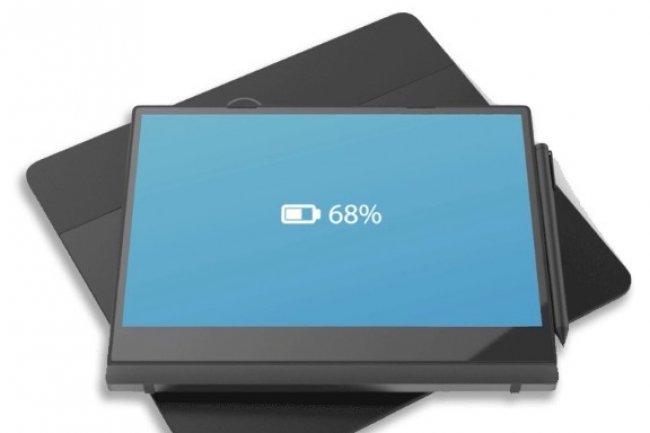 Le Latitude 7285 de Dell, un ordinateur portable 2-in-1 et son tapis de recharge sans fil.