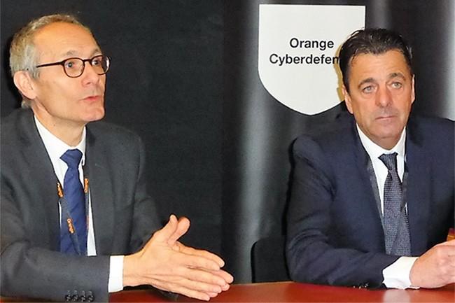 Thierry Bonhomme, directeur d'Orange Business Services et Michel Van Den Berghe, PDG d'Orange Cyberdefense à l'occasion d'une conférence de presse organisée au FIC 2017. (crédit : Dominique Filippone)