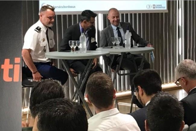 La cybermatinée Sécurité à Bordeaux a laissé place aux débats auxquels ont notamment partiipé de gauche à droite, Jean-Christophe Fedherbe (adjudant chef cellule Identification Criminelle de Bordeaux), Guy Flament (délégué sécurité du numérique Nouvelle-Aquitaine de l'ANSSI), Vincent Riou (CEO Bluecyforce). (crédit : LMI)