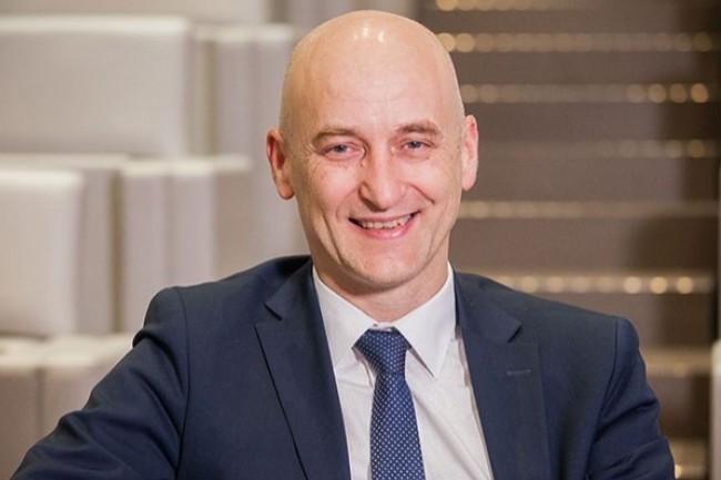 Marc Philippe, DSI groupe du réassureur SCOR, opère un SI unique mondial pour toutes les entités du groupe. (Crédit : CIO/Alexia Perchant)