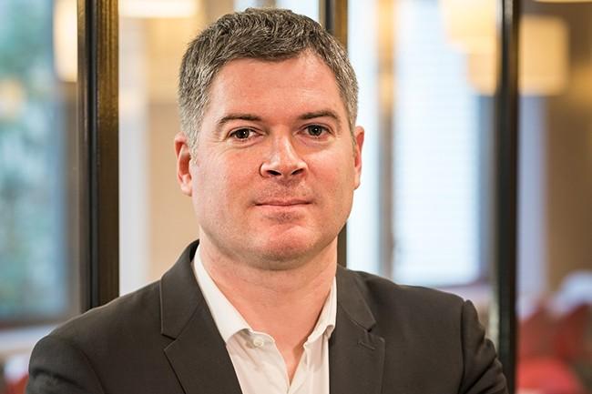 Arrivé il y a trois ans à la direction du système d'information de Compass Group, Olivier Malvezin est à l'initiative du projet de borne de paiment automatisé dans les restaurants d'entreprises. (Crédit : Compass Group)