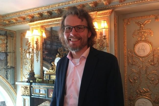 Andrew Filev, CEO de Wrike en 2006, lors de son passage à Paris début juin, nous a indiqué que sa R&D travaillait sur des fonctions prédictives. (Crédit : LMI/MG)