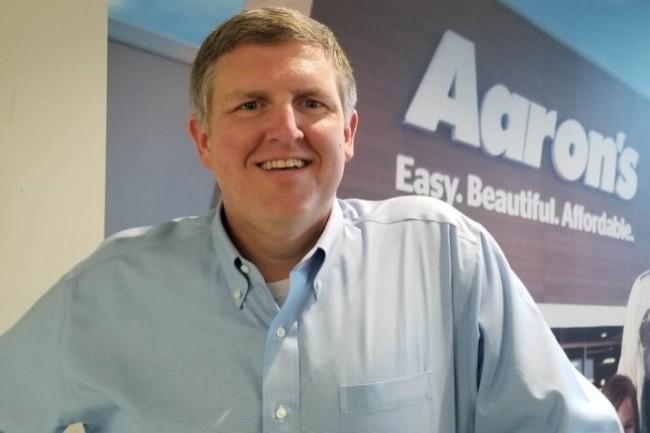 John Trainor, DSI d'Aaron's a modernisé l'IT et la façon de travailler pour s'orienter plus produits et business. (Crédit Photo : Aaron)