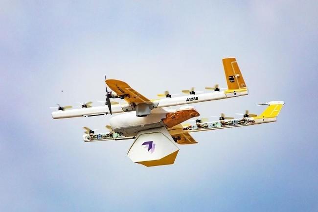 Les drones de Wing (Alphabet) transportent de petits colis qu'ils livrent gr�ce � un filin, depuis 7 m�tres d'altitude.�(Photo Wing Aviation LLC/Alphabet)